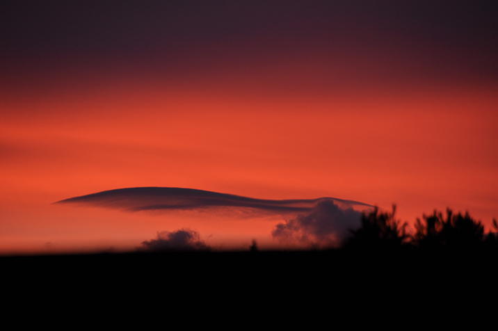 red sky with cloud lines